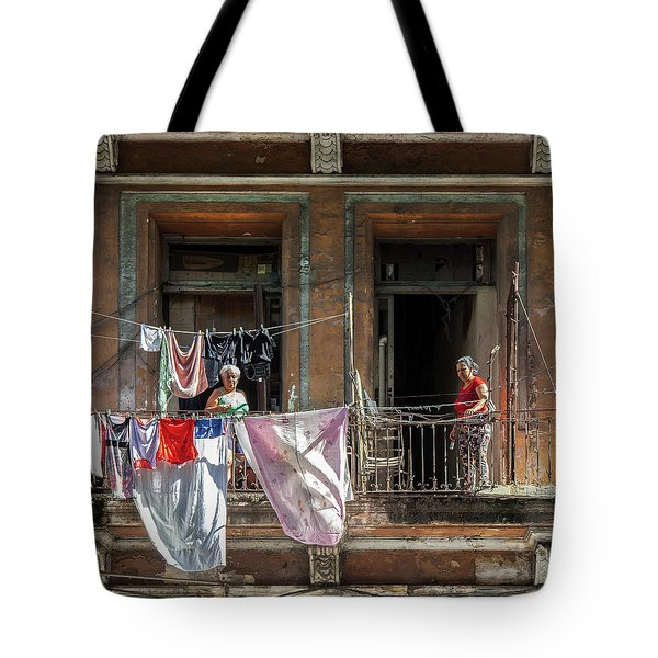 Tote Bag featuring the photograph Cuban Women Hanging Laundry In Havana Cuba by Charles Harden