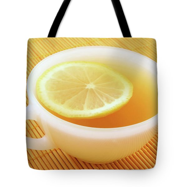 Cup Of Tea With Lemon In Warm Golden Light Tote Bag