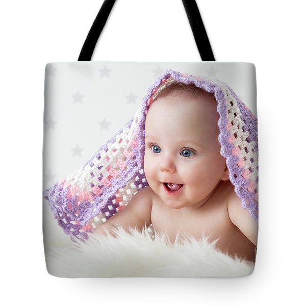 Cute Baby Laughing While Lying Under A Woollen Blanket. Tote Bag by Michal Bednarek
