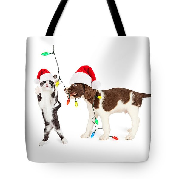 Cute Kitten And Puppy Playing With Christmas Lights Tote Bag