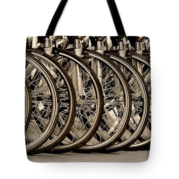 Tote Bag featuring the photograph Cycles by Joe Bonita