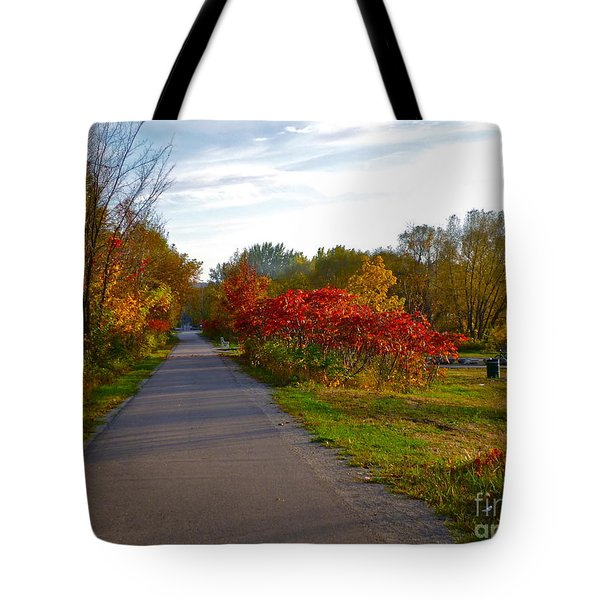 Tote Bag featuring the photograph Cycling In Heaven by Claire Bull