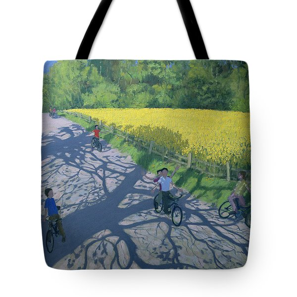 Cyclists And Yellow Field Tote Bag by Andrew Macara