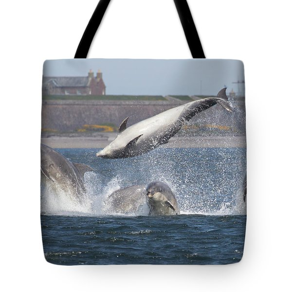 Tote Bag featuring the photograph Dance Of The Dolphins by Karen Van Der Zijden