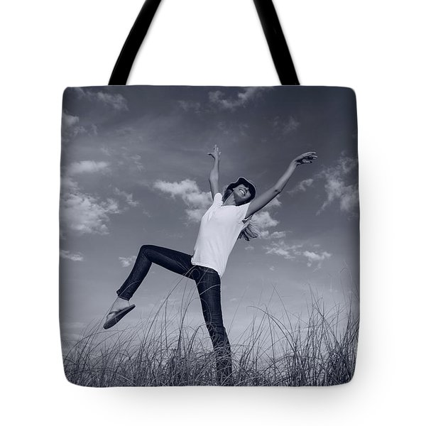 Dancing At The Beach Tote Bag by Amyn Nasser