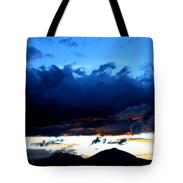 Tote Bag featuring the photograph Dancing Clouds by Silke Brubaker