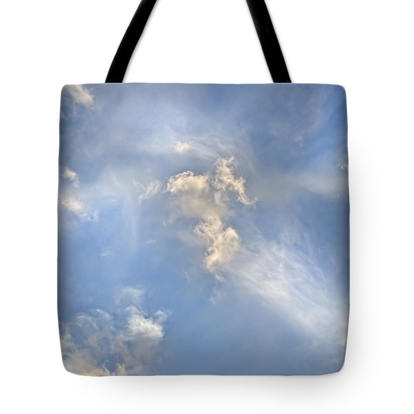 Tote Bag featuring the photograph Dancing Clouds by Wanda Krack