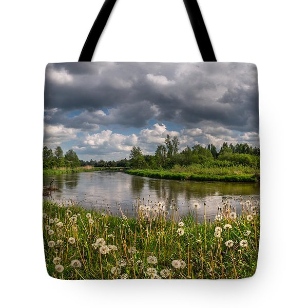 Tote Bag featuring the photograph Dandelion Field On The River Bank by Dmytro Korol