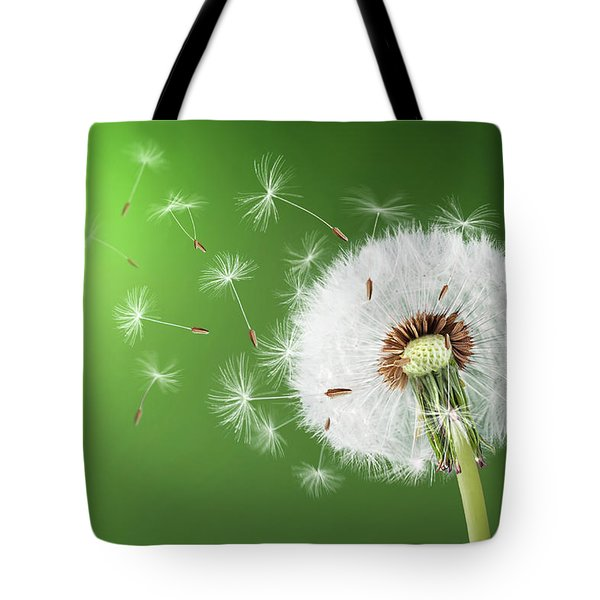Tote Bag featuring the photograph Dandelion Seeds by Bess Hamiti