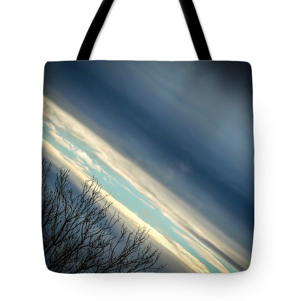 Dark Clouds Parting Tote Bag