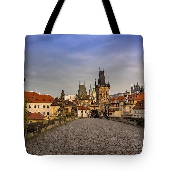 Dawn Breaks Over Prague From The St. Charles Bridge Tote Bag