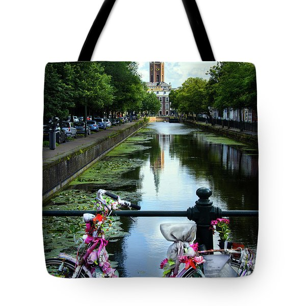 Tote Bag featuring the photograph Canal And Decorated Bike In The Hague by RicardMN Photography