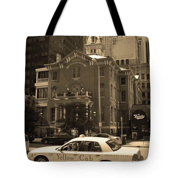 Tote Bag featuring the photograph Denver Downtown With Yellow Cab Sepia by Frank Romeo