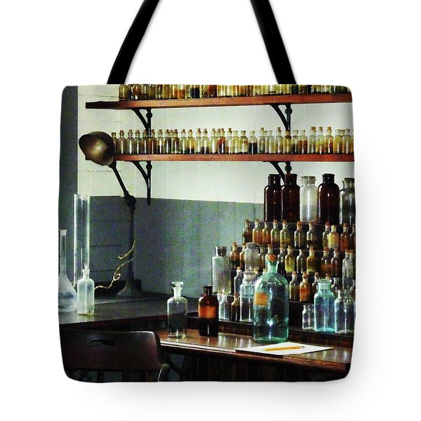 Desk With Bottles Of Chemicals Tote Bag by Susan Savad