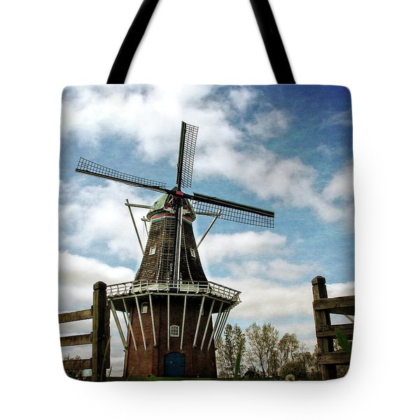 Tote Bag featuring the photograph Dezwaan Windmill With Fence And Clouds by Michelle Calkins