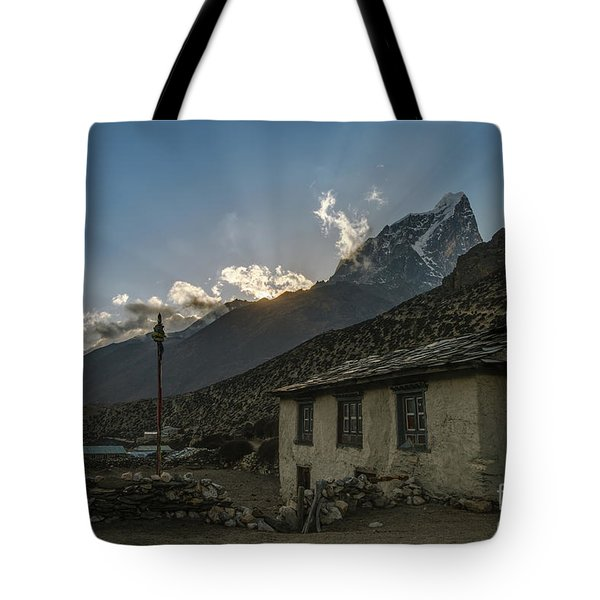 Tote Bag featuring the photograph Dingboche Nepal Sunrays by Mike Reid