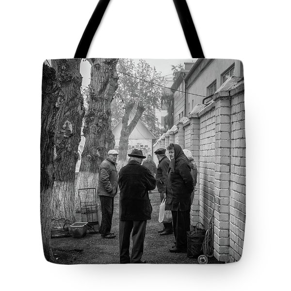 Tote Bag featuring the photograph Discussion by John Williams