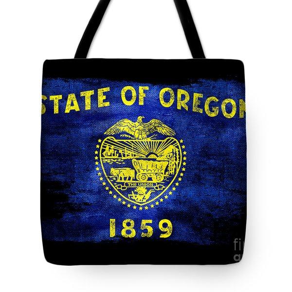 Distressed Oregon Flag On Black Tote Bag by Jon Neidert