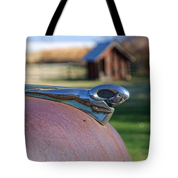 Tote Bag featuring the photograph Dodge Emblem by Ely Arsha