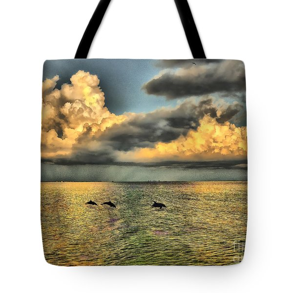Dolphins Play At Sanibel Island Tote Bag
