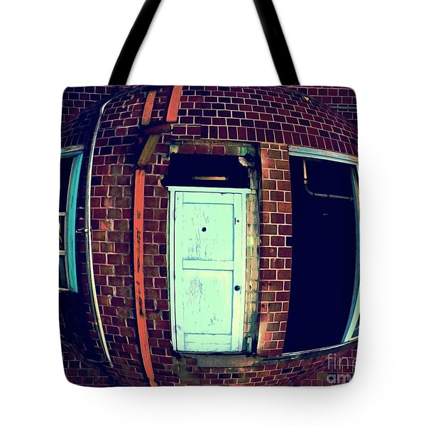 Tote Bag featuring the photograph Door To Nowhere by Yulia Kazansky