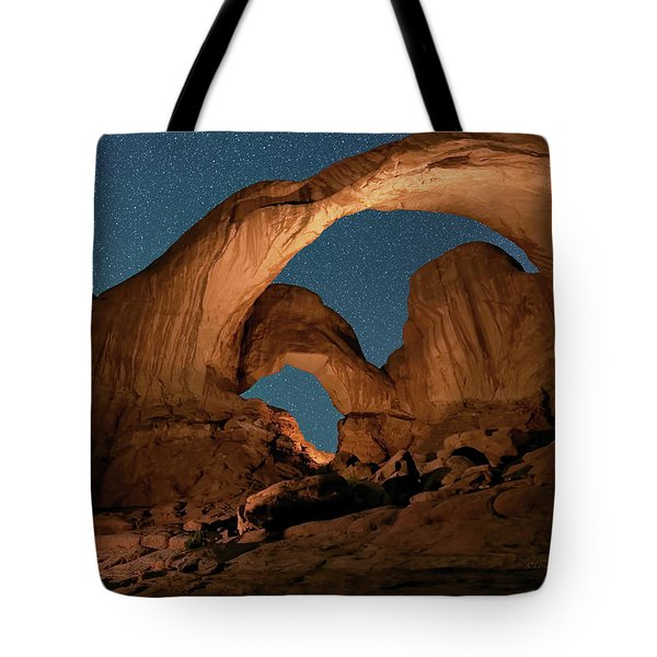 Tote Bag featuring the photograph Double Arch And The Milky Way - Arches National Park - Moab, Utah. by OLena Art Brand