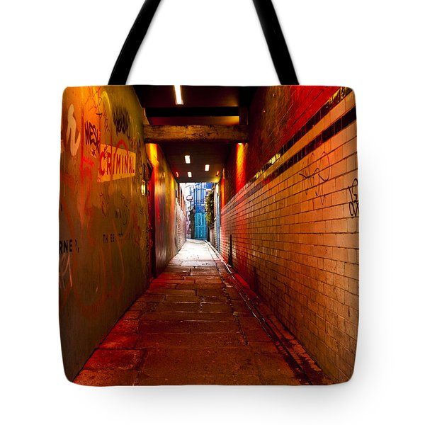 Down The Red Tunnel Tote Bag by Rae Tucker