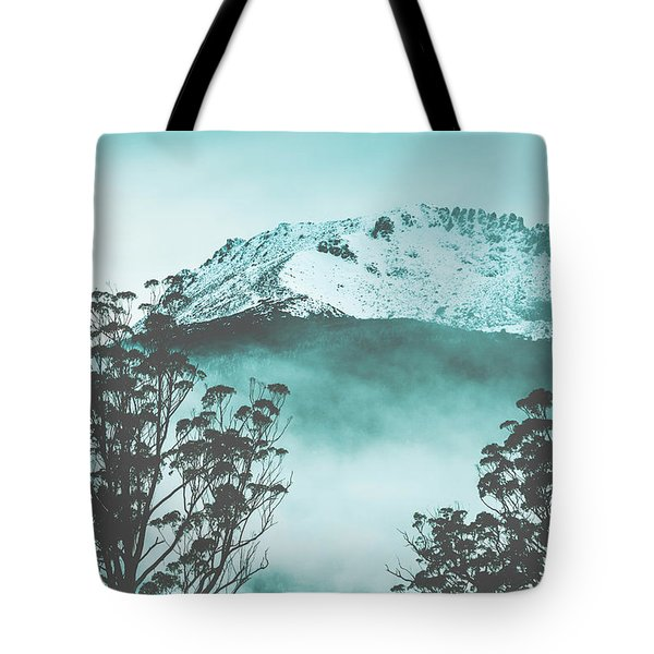 Dramatic Dark Blue Mountain With Snow And Fog Tote Bag