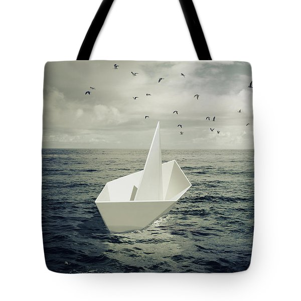 Tote Bag featuring the photograph Drifting Paper Boat by Carlos Caetano