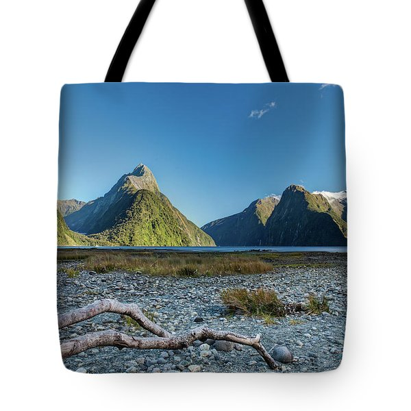 Tote Bag featuring the photograph Driftwood In Milford Sound by Gary Eason