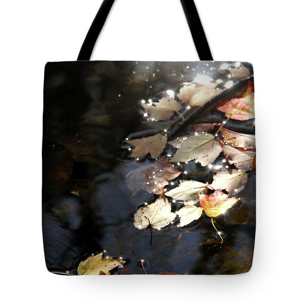 Dry Leaves Floating On The Surface Of A Stream Tote Bag