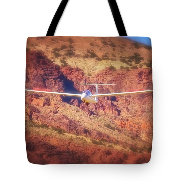 Duo Discus Over Red Rocks Tote Bag