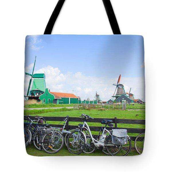 dutch windmills with bikes in Zaanse Schans Tote Bag