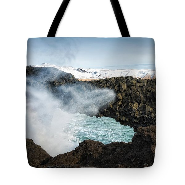 Tote Bag featuring the photograph Dyrholaey Rock Arch Iceland by Matthias Hauser