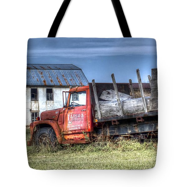 Tote Bag featuring the photograph Earl Latsha Lumber Company - Version 1 by Shelley Neff