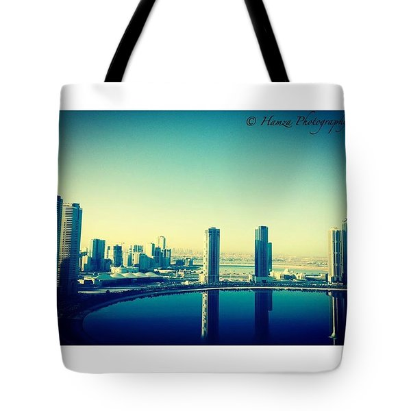 Morning View With Still Water Relflecting The Buildings Tote Bag