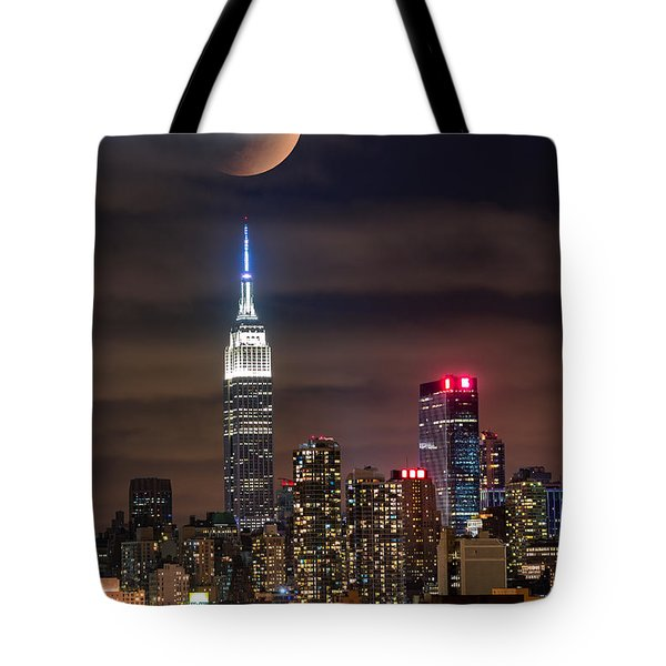 Tote Bag featuring the photograph Eclipse by Mihai Andritoiu
