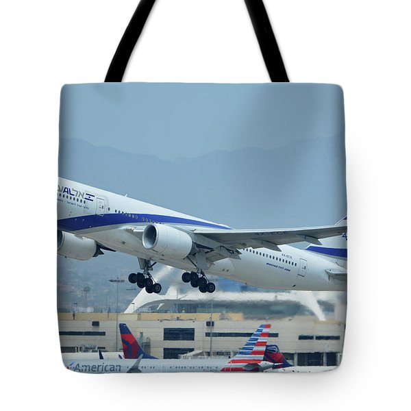 Tote Bag featuring the photograph El Al Boeing 777-258er 4x-ece Los Angeles International Airport May 3 2016 by Brian Lockett