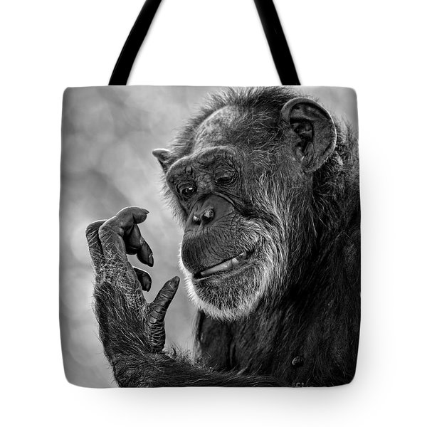 Elderly Chimp Studying Her Hand Tote Bag