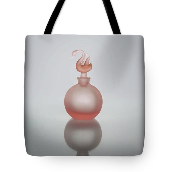 Tote Bag featuring the photograph Elegant Frosted Pink Vintage Perfume Bottle by David and Carol Kelly