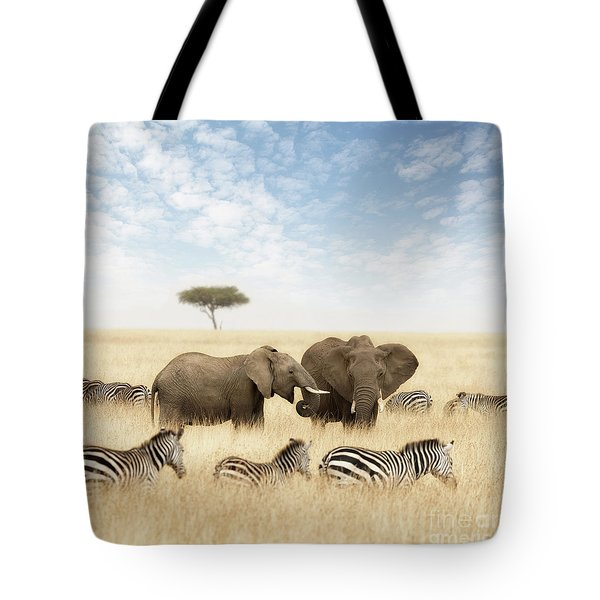 Elephants And Zebras In The Grasslands Of The Masai Mara Tote Bag