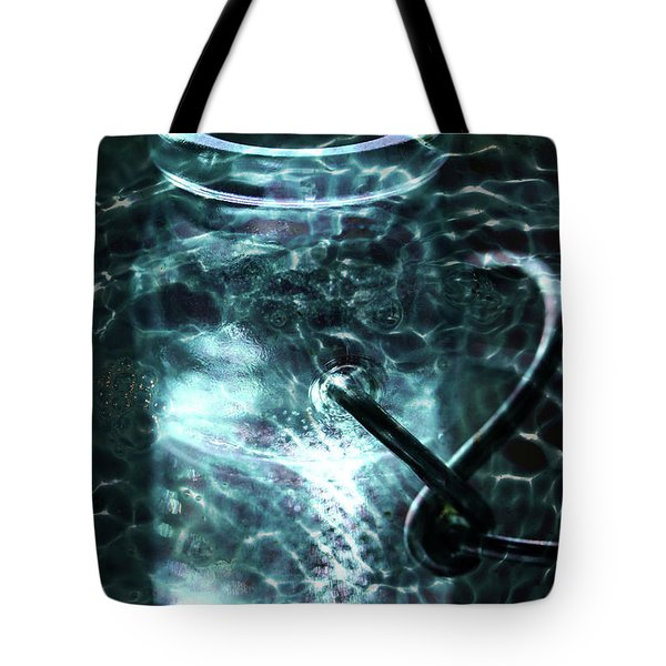 Tote Bag featuring the photograph Elixar by Stephen Mitchell