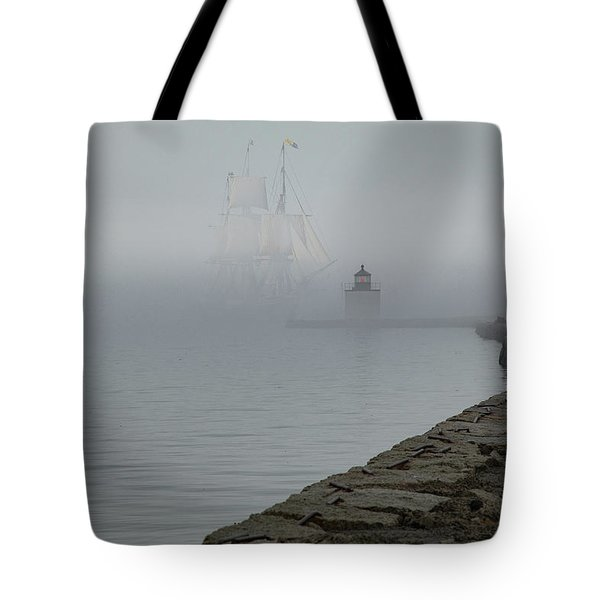 Tote Bag featuring the photograph Emerging From The Fog by Jeff Folger