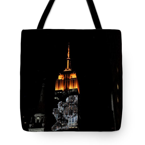 Tote Bag featuring the photograph Endangered Species Light Show On The Empire State Building by Diane Lent
