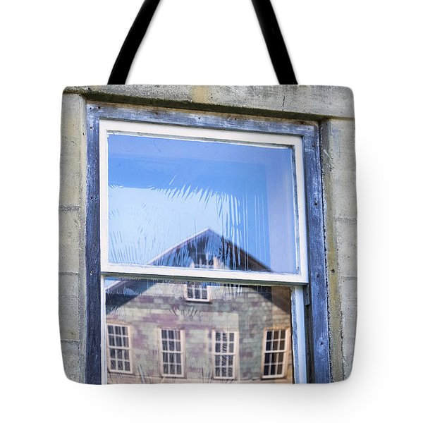 Tote Bag featuring the photograph Estey Window Reflection by Tom Singleton