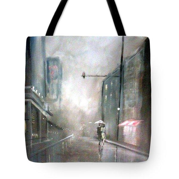 Evening Walk In The Rain Tote Bag by Raymond Doward