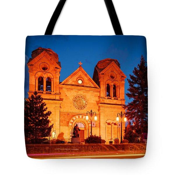 Facade Of Cathedral Basilica Of Saint Francis Of Assisi At Twilight- Santa Fe New Mexico Tote Bag