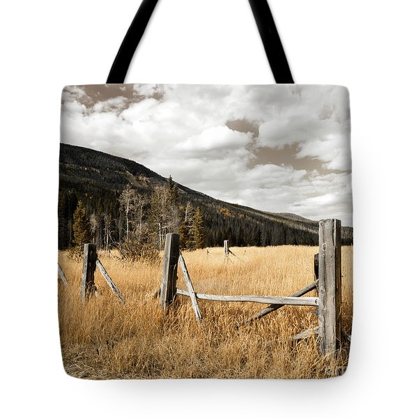 Tote Bag featuring the photograph Fallowfield Weathered Fence Rocky Mountain National Park Dramatic Sky by John Stephens