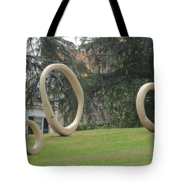 Tote Bag featuring the photograph Family Of O's by Aaron Martens