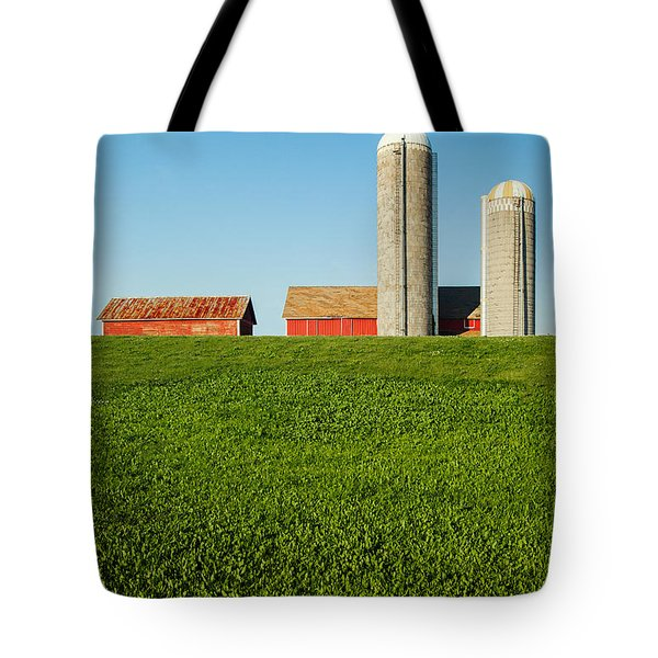 Farm Silos And Shed On Green And Against Blue Tote Bag